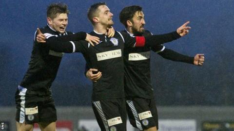 St Mirren captain Stephen McGinn celebrates scoring against Dumbarton