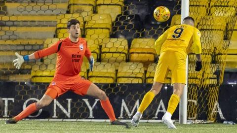 Dykes' diving header completed his hat-trick and Livingston's win