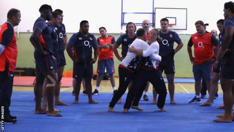England players watch instructors
