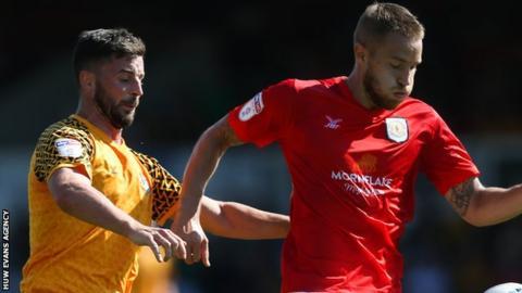 Padraig Amond of Newport County challenges Olly Lancashire of Crewe Alexandra