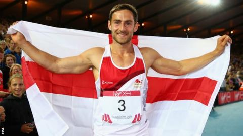 Ashley Bryant celebrates with the England flag