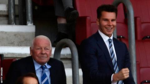 David Sharpe (right) took over as Wigan Athletic chairman from his grandfather Dave Whelan (left) in 2015