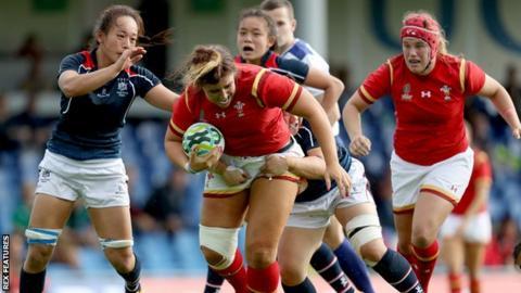 Wales vs Hong Kong. Wales Shona Powell-Hughes and Lee Ka Shun of Hong Kong