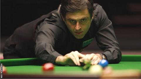 Ronnie O'Sullivan lines up a shot