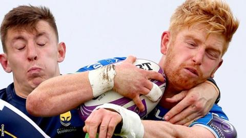 Darragh Leader keeps hold of possession for Connacht despite pressure from Josh Adams