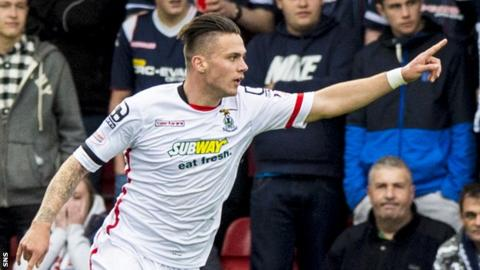 Miles Storey celebrates scoring for Inverness Caledonian Thistle