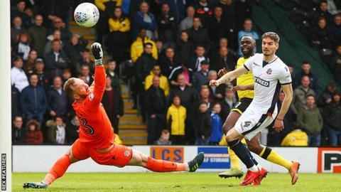 Hope Akpan scores Burton's opening goal against Burton
