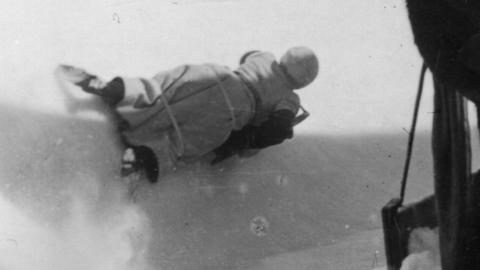 A woman racing down the Cresta Run