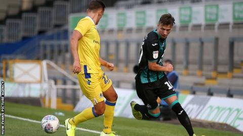 Bersant Celina launches a Swansea attack against Bristol Rovers