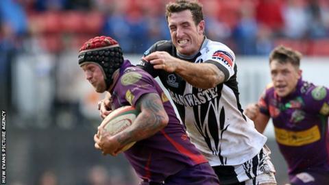 Ronny Kynes is tackled by Pontypridd's Dafydd Lockyer