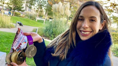 Samantha Murray shows off her medals