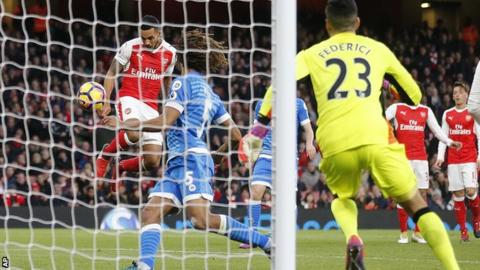 Theo Walcott heads in for Arsenal against Bournemouth