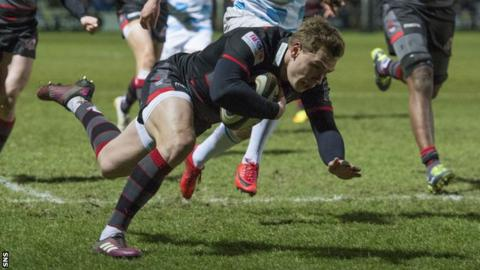 Edinburgh scrum-half Nathan Fowles streaks away to score their second try