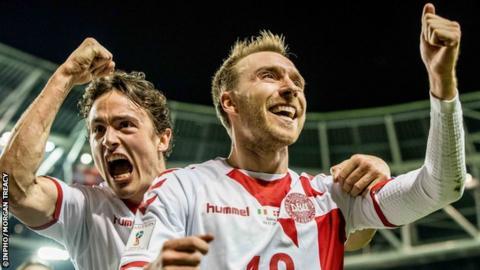 Denmark's Christian Eriksen celebrates his hat-trick goal with Thomas Delaney