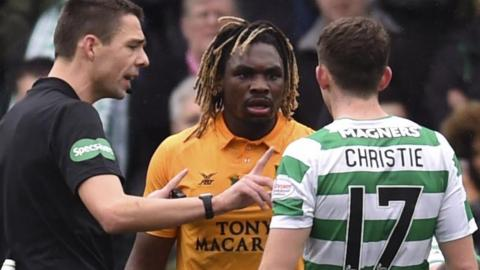 Livingston's Dolly Menga comes head to head with Celtic's Ryan Christie and is spoke to by referee Kevin Clancy