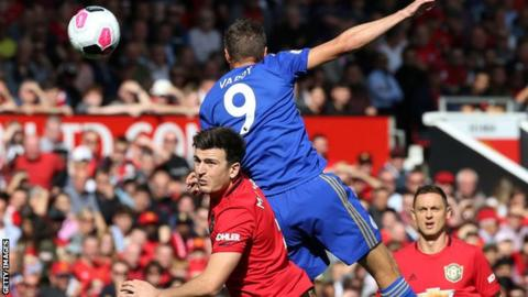 Harry Maguire and Jamie Vardy in an aerial duel