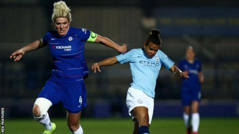 Man City striker Nikita Parris is challenged by England team-mate Millie Bright