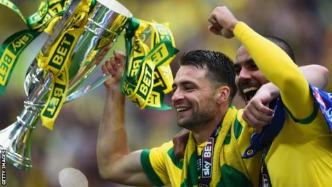 Russell Martin (left) celebrates Norwich getting promoted