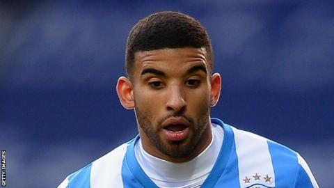 Oscar Gobern plays for Huddersfield Town against Charlton Athletic in the FA Cup in 2014