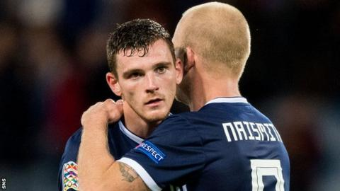 Andy Robertson and Steven Naismith embrace