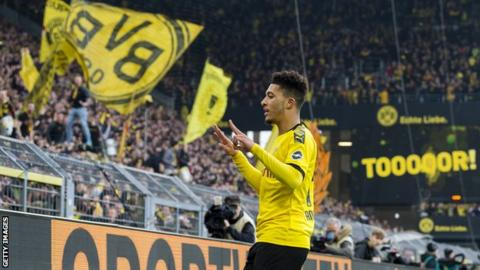 Jadon Sancho celebrates scoring