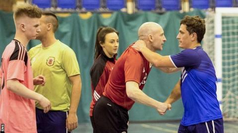 Scotland manager Mark Potter congratulates a Gibraltar opponent