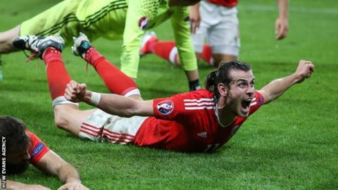 Gareth Bale celebrates with Wales after reaching the semi-final of Euro 2016