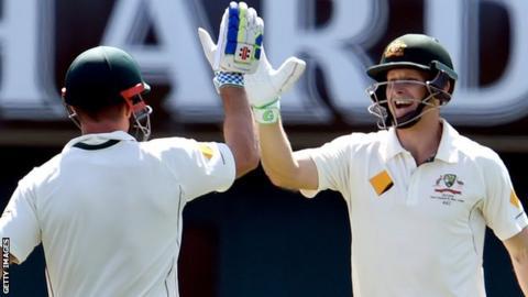 Adam Voges (right) celebrates his century with Shaun Marsh