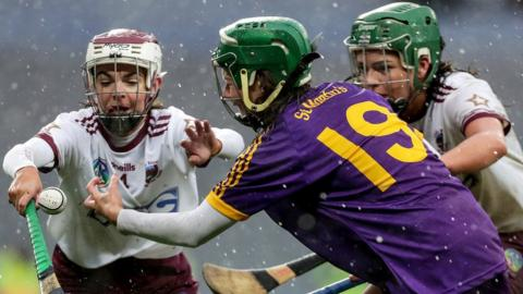 Slaughtneil duo Ceat McEldowney and Shannon Graham compete with St Martin's Lisa Firman