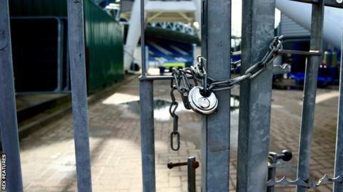Locked gates at football stadium