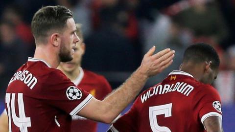 Liverpool captain Jordan Henderson consoles team-mate Georginio Wijnaldum