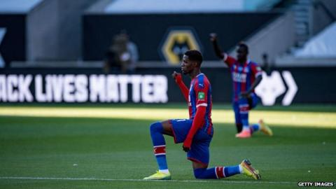 sports Crystal Palace forward Wilfried Zaha takes the knee