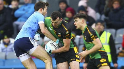 Moy's goal scorer Tom Loughran attempts to dispossess a Michael Glavey's opponent during the Intermediate final in Dublin