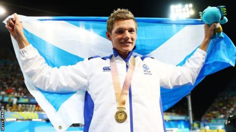 Duncan Scott celebrates his 100m freestyle gold at the Commonwealth Games