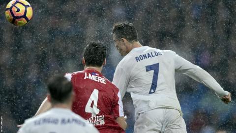 Cristiano Ronaldo scores against Sporting Gijon