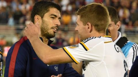 Luis Suarez and Steven Gerrard embrace before a friendly in Los Angeles