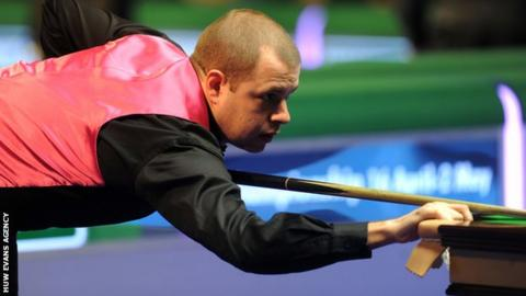 Barry Hawkins lines up a shot in Cardiff