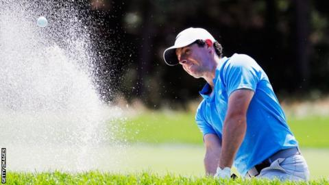 Rory McIlroy plays a bunker shot on Sunday