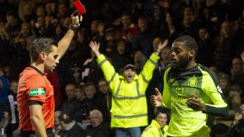 Referee Andrew Dallas issues Olivier Ntcham with a red card