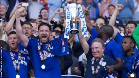 Sean Morrison (L) celebrates promotion to the Premier League with Cardiff City manager Neil Warnock