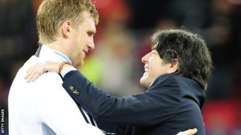 Per Mertesacker and Joachim Low
