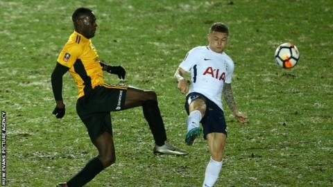 Frank Nouble and Kieran Trippier challenge for the ball during Spurs' trip to Rodney Parade.