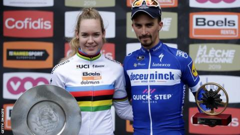 Fleche Wallonne winners Anna van der Breggen (left) and Julian Alaphilippe (right) pose with their trophies