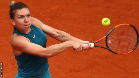 Fired-up Halep battles into second round