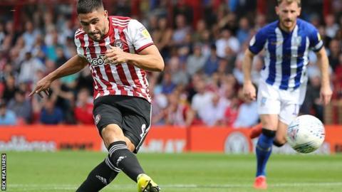 Brentford striker Neal Maupay scores against Sheffield Wednesday