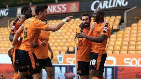 Danny Batth helps Benik Afobe celebrate Wolves' second goal against Huddersfield Town