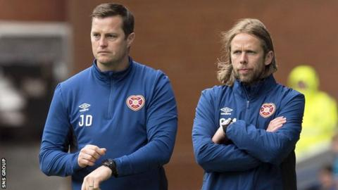 Interim head coach Jon Daly and assistant Austin McPhee