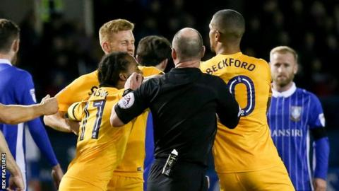 Eoin Doyle and Jermaine Beckford come to blows
