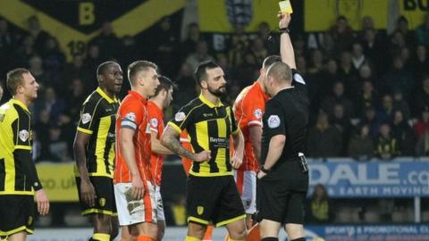 Robbie Weir is shown a second yellow card