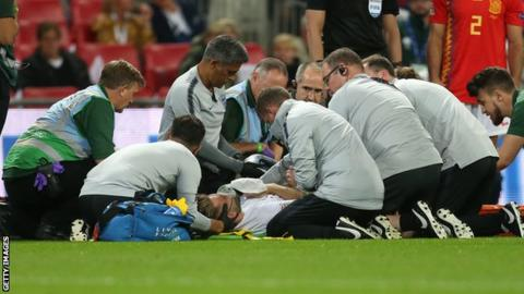 Luke Shaw receives treatment at Wembley